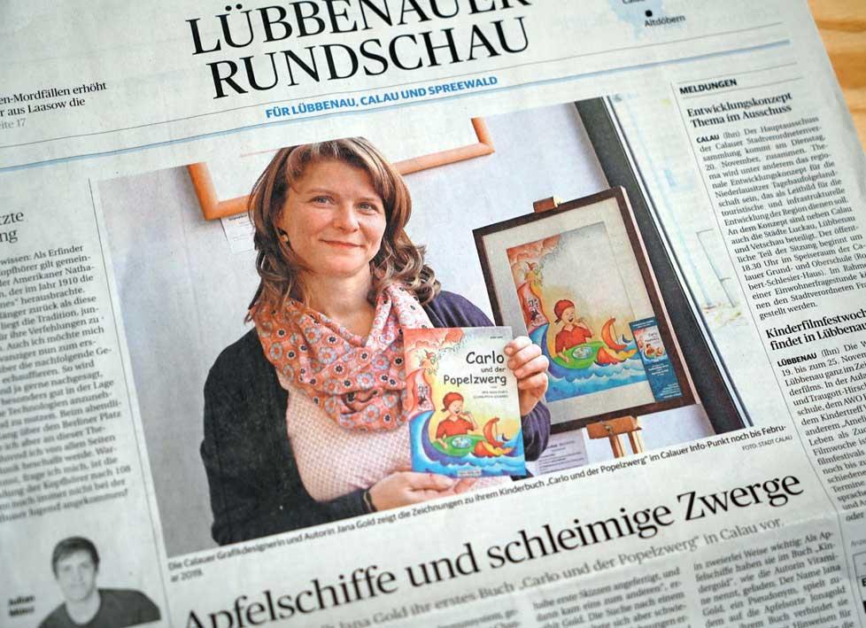 Zeitungsartikel mit Farbfoto: Autorin Jana Gold präsentiert ihr Buch